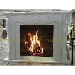 Каминный портал в классическом стиле из белого мрамора Тассос