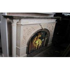 """Каминный портал выполненный в сочетании двух цветов мрамора """"Имперадор дарк"""" и """"Голден лайт"""""""